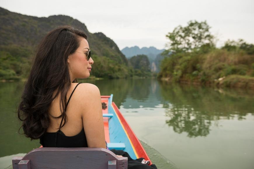 Woman enjoying boat ride, Nam Song River, Vang Vieng, Laos, Indochina, Asia