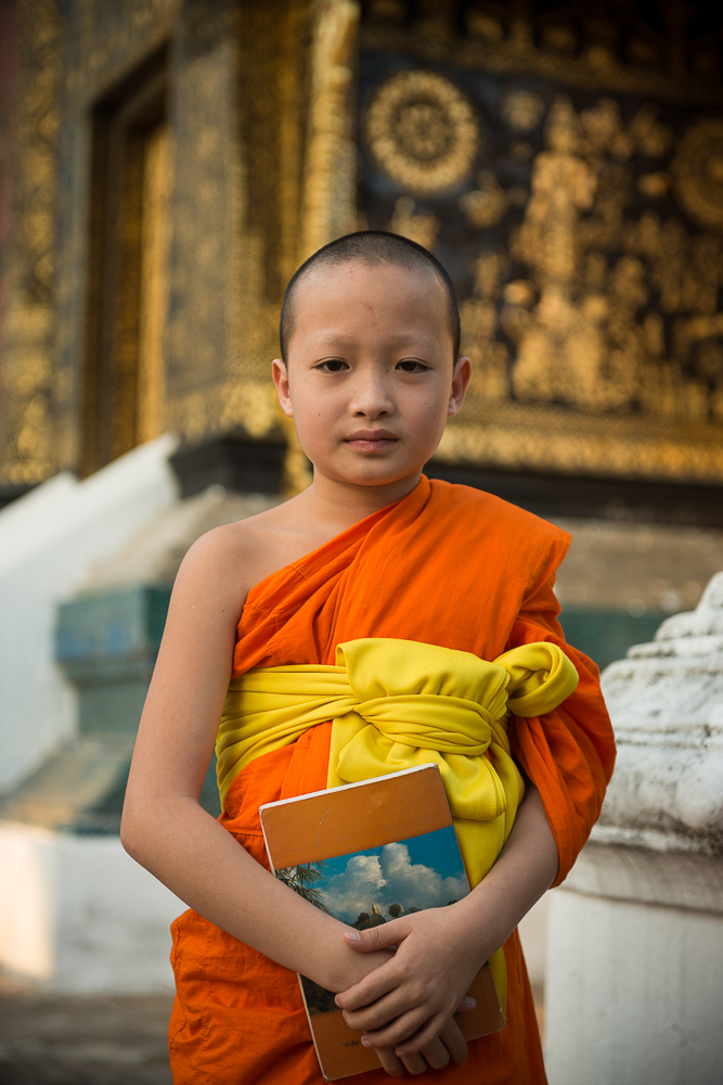 Buddhist Monk outside Wat Xieng Thong, Luang Prabang, Laos, Indochina, Asia