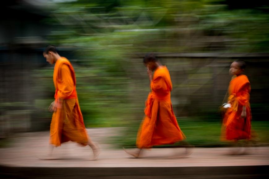 Buddhist Monks during Alms giving ceremony 'Tak Bat', Luang Prabang, Laos, Indochina, Asia