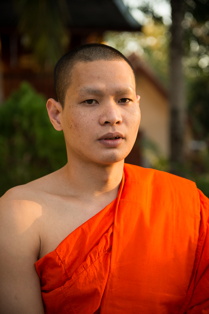Buddhist Monk outside Wat Xieng Thong, Luang Prabang, Laos, Indochina, Asia