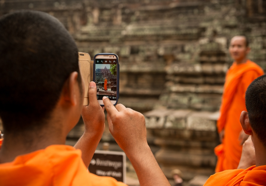 Buddhist Monks taking photographs of each other, Phimeanakas Temple, Angkor Thom, Siem Reap, Cambodia