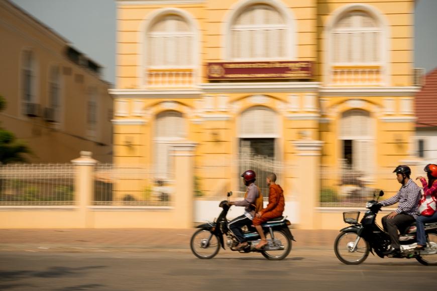 Panning shots of traffic outside Colonial style buildings, Battambang, Battambang Province, Cambodia, Indochina, Asia