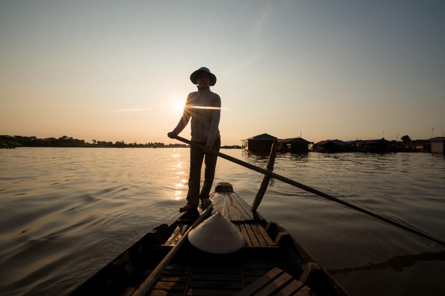 Boatwoman 'Mai'  guiding boat through Tonle Sap River, Floating Villages of Phoum Kandal, Kompong Chnang, Cambodia, Indochina, Asia