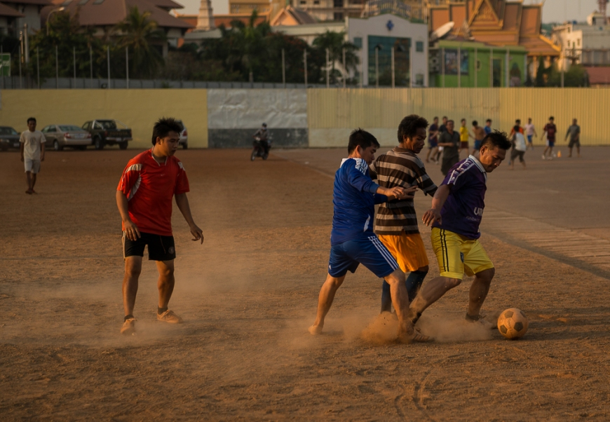 Soccer game, Olympic Stadium at dusk, Phnom Penh, Cambodia, Indochina, Asia