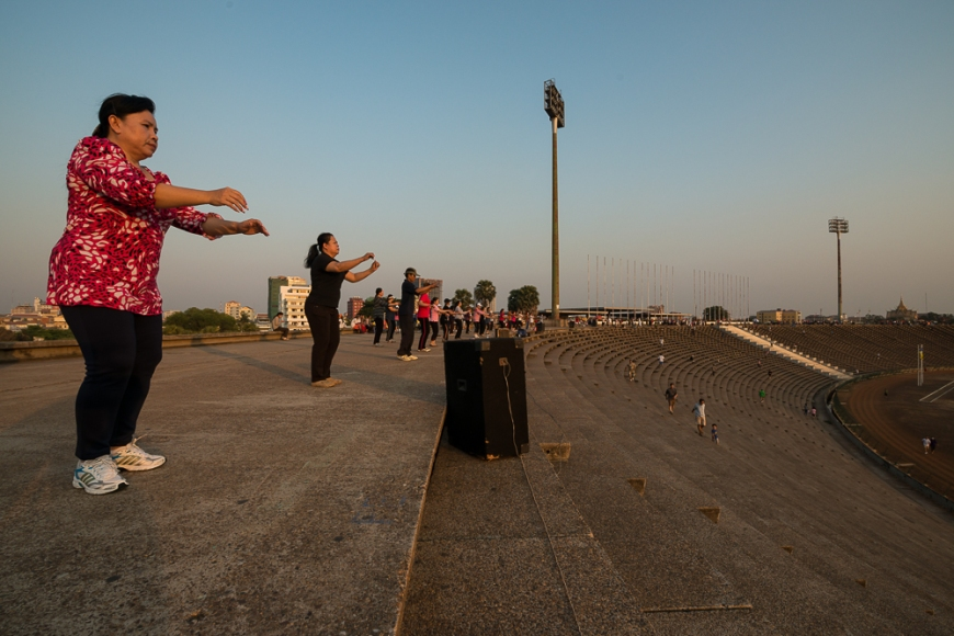 Aerobics Sessions at Olympic Stadium at dusk, Phnom Penh, Cambodia, Indochina, Asia
