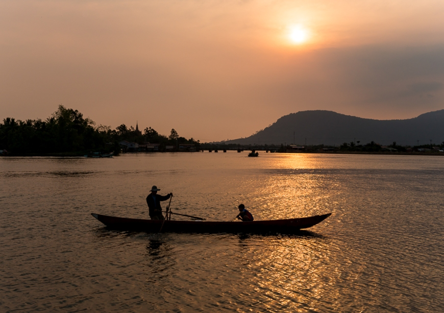 Father and son fishing on Kampong Bay River at sunset, Kampot, Cambodia, Indochina, Asia