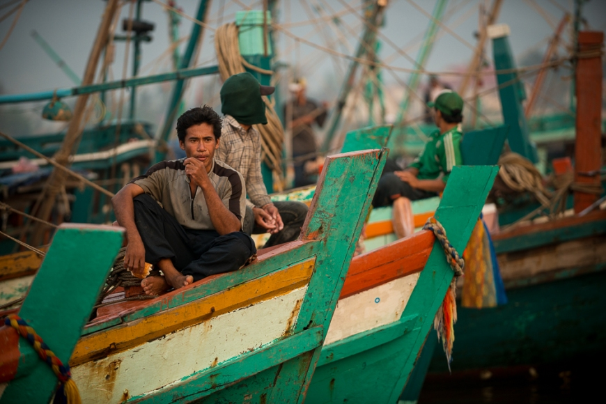 Dawn at Kampot Harbour as fishing boats return with nights catch, Kampot Province, Cambodia, Indochina, Asia