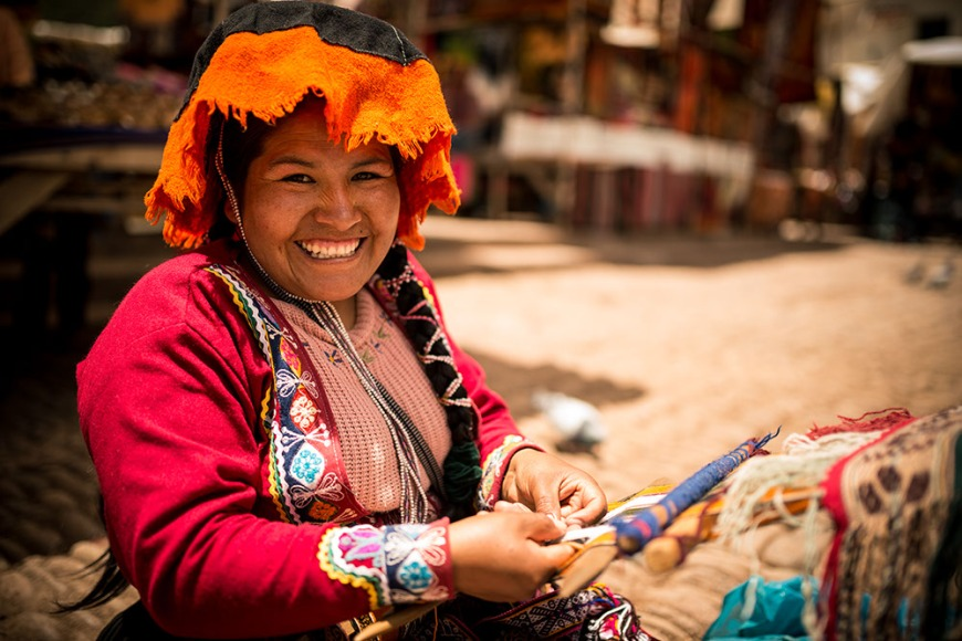 Luisa weaving in traditional dress, Pisac Textiles Market, Sacred Valley, Peru