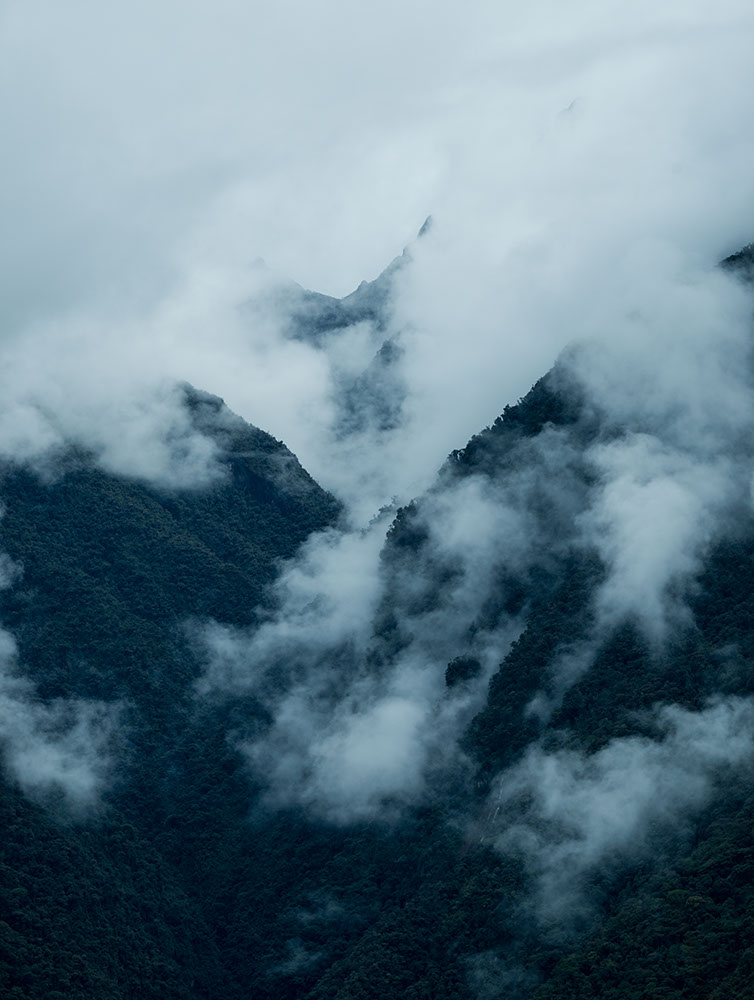 Mist rising over Mountains near Machu Picchu, The Sacred Valley, Peru