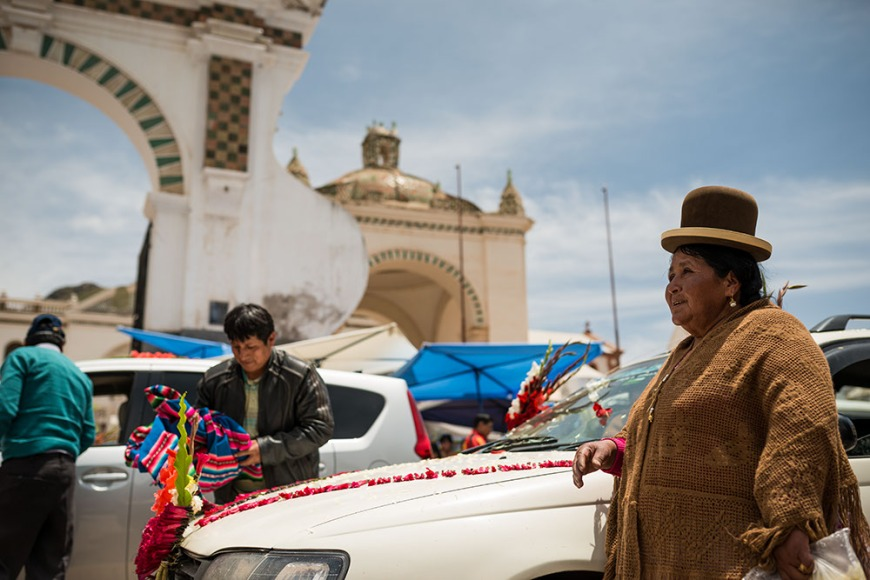 Weekly ritual of blessing vehicles known as 'Ch'alla' outside the Cathedral, Copacabana, Lake Titicaca, Bolivia