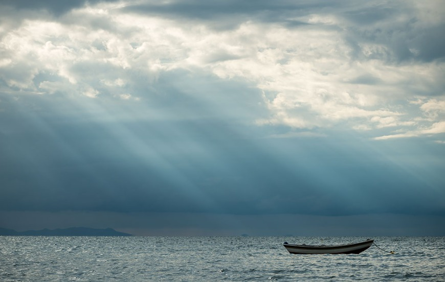 Lone boat in water, Copacabana, Lake Titicaca, Bolivia