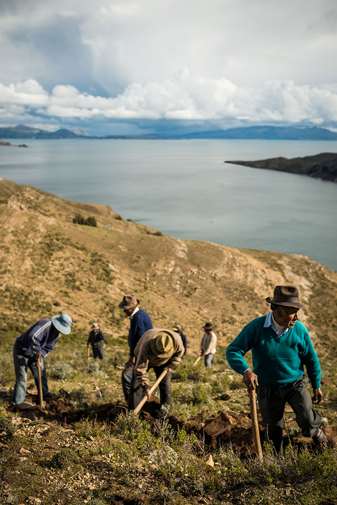 Local Bolivians working on repairing the Inca Trail, Isla del Sol, Lake Titicaca, Bolivia