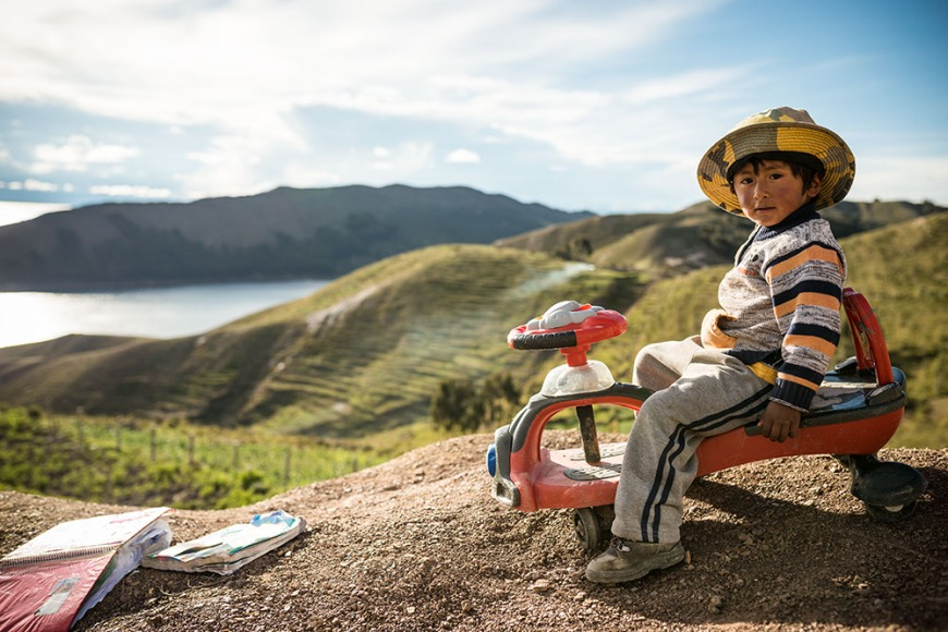 Portrait of Miguel on his tricycle, Yumani, Isla del Sol, Lake Titicaca, Bolivia