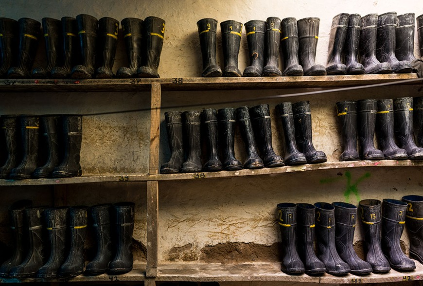 Boots ready for tourists visiting the Cerro Rico mines, Potosi, Southern Altiplano, Bolivia