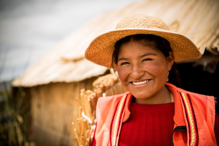 Portrait of Norma wearing traditional hat, Uros Islands, Lake Titicaca, Puno, Peru