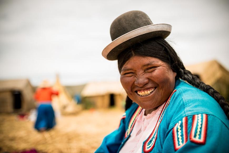 Portrait of Benita wearing traditional Bolivian bowler hat, Uros Islands, Lake Titicaca, Puno, Peru