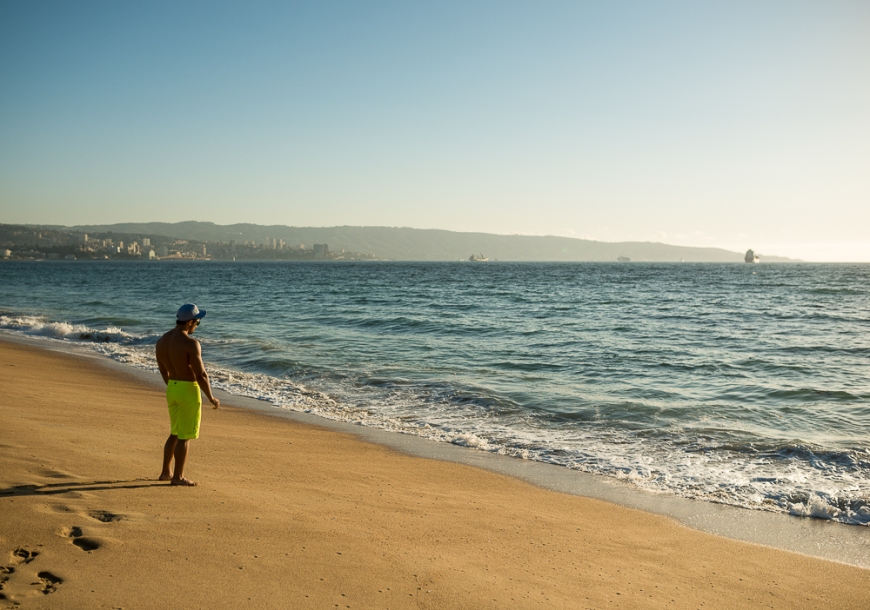Man standing on beach, Playa Los Marineros, Viña del Mar, Central Coast, Chile