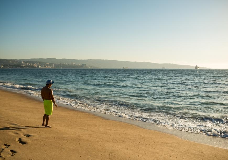 Man standing on beach, Playa Los Marineros, Viña del Mar, Central Coast, Chile