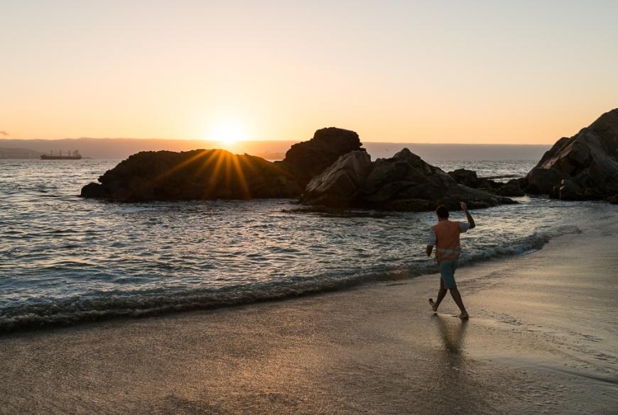 Man fishing at Playa Los Marineros at dusk, Viña del Mar, Central Coast, Chile