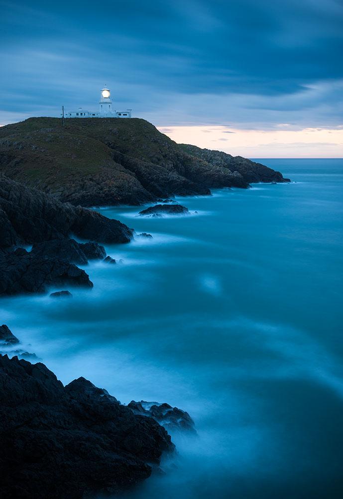 Strumble Head Lighthouse at dusk, Pembrokeshire Coast National Park, Wales, UK