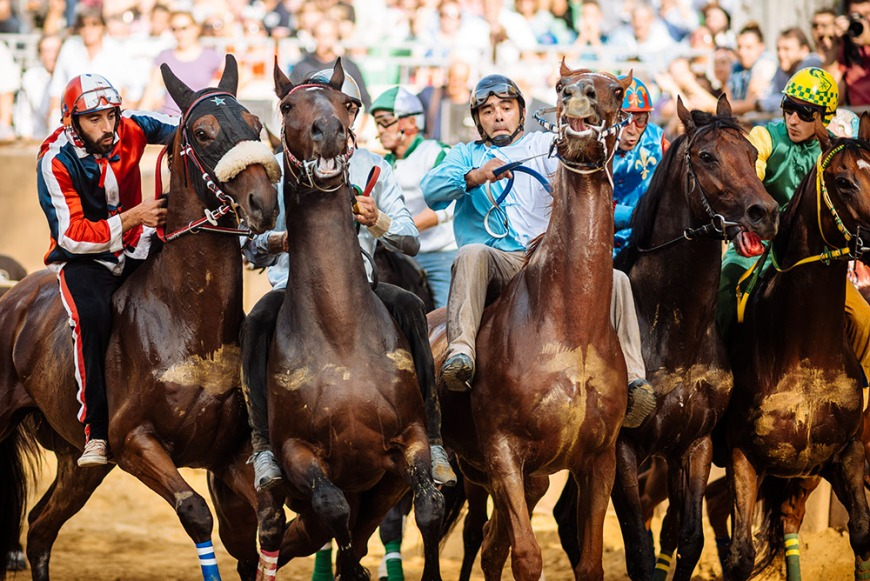 Jockeys jostle for position for the start of the Palio Di Asti on September 21, 2014 in Asti, Italy