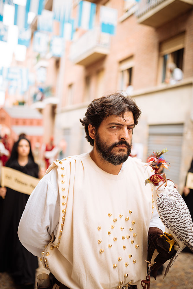 A man in a medieval costume takes part in a historical parade from the Piazza Cattedrale to the race track ahead of the Palio Di Asti on September 21, 2014 in Asti, Italy