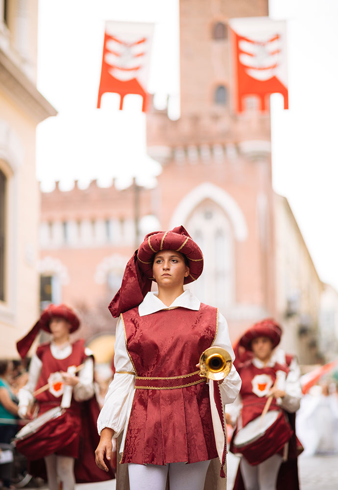 People in a medieval costume take part in a historical parade from the Piazza Cattedrale to the race track ahead of the Palio Di Asti on September 21, 2014 in Asti, Italy