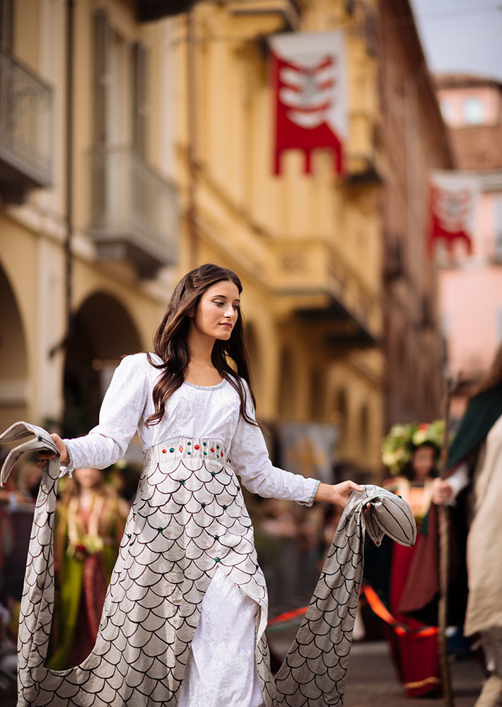 A girl in a medieval costume takes part in a historical parade from the Piazza Cattedrale to the race track ahead of the Palio Di Asti on September 21, 2014 in Asti, Italy