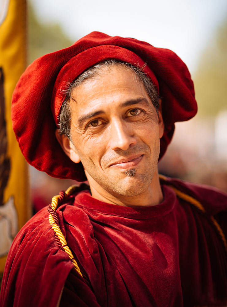 Portrait of man in traditional medieval costume ahead of the Palio di Asti