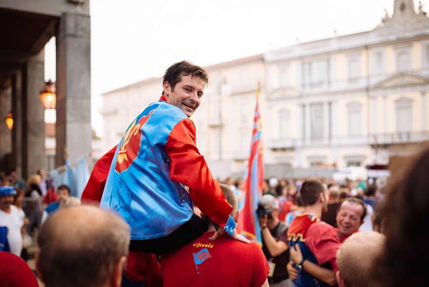 Andrea 'Brio' Mari of Rione Santa Caterina district celebrates winning the Palio Di Asti