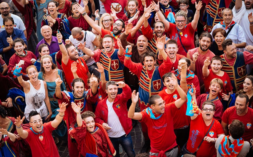 Fans of Rione Santa Caterina district celebrate winning the Palio Di Asti on September 21, 2014 in Asti, Italy