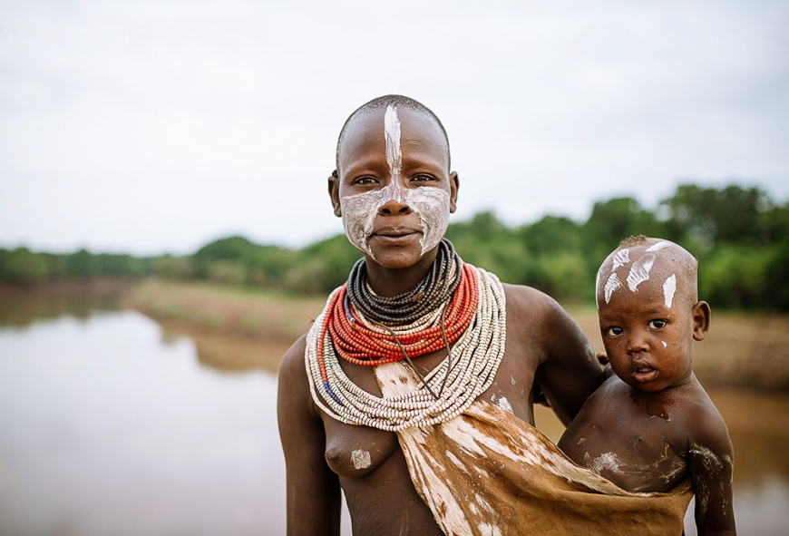 Portrait of Kore with baby, Kara Tribe, Duse Village, Omo Valley, Ethiopia