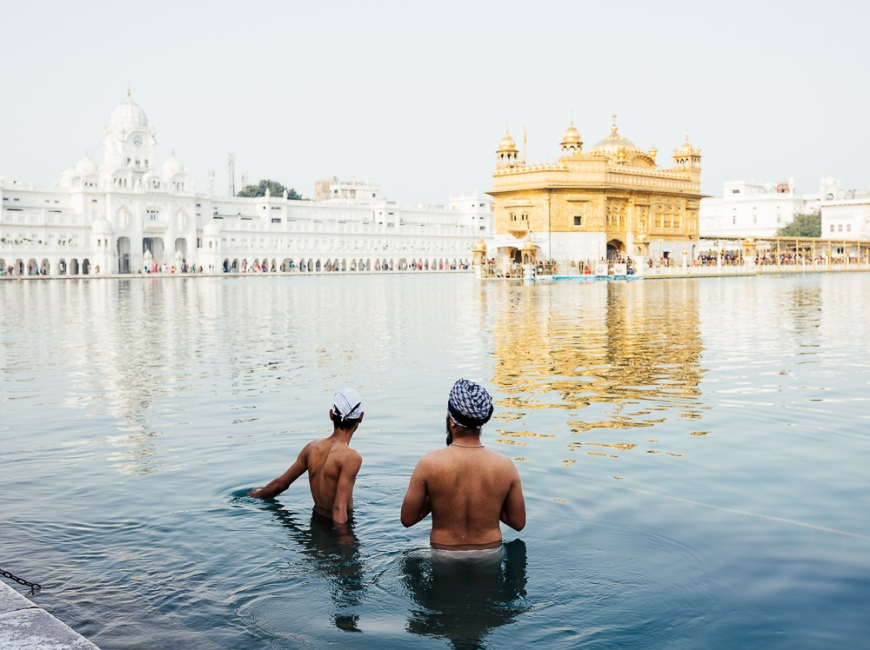 Men bathing at Harmandir Sahib (Golden Temple), Amritsar, Punjab, India