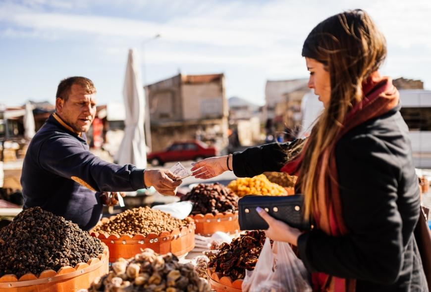 Young woman buying dried fruits, Uçhisar, Cappadocia, Anatolia Region, Turkey