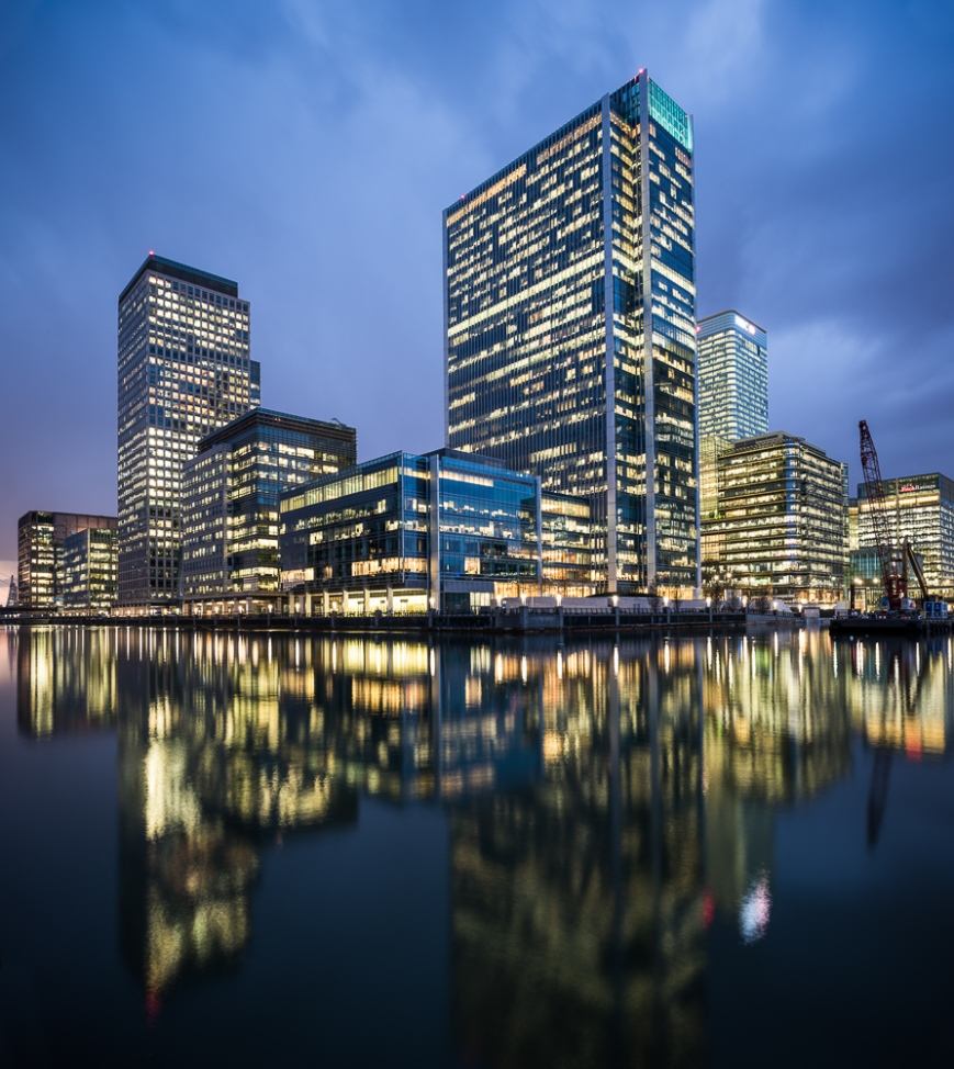 View of Canary Wharf at night from South Dock, London, England