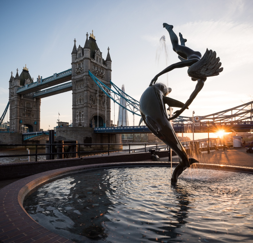 Fountain of a girl and dolphin at sunset, Tower Bridge, London, England