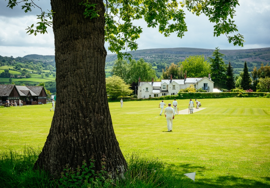 Cricket game in Crickhowell, Brecon Beacons, POWYS, Wales