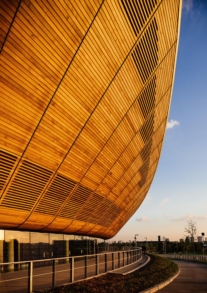 Evening light on exterior of The Velodrome, Queen Elizabeth Olympic Park, Stratford, London, UK