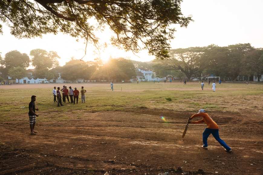 Boys playing cricket in the early morning light, Fort Kochi (Cochin), Kerala, India