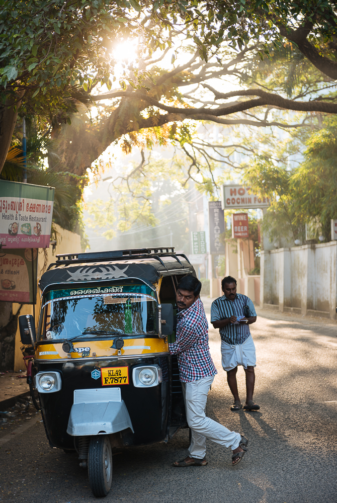 Rickshaw backlit by early morning light, Fort Kochi (Cochin), Kerala, India
