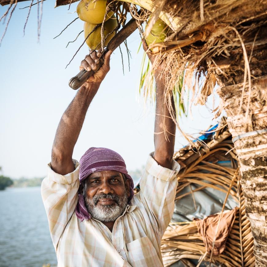 Anthony preparing fresh coconut, Backwaters near North Paravoor, Kerala, India