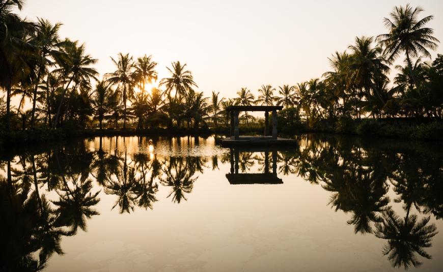 View of lake at sunset, backwaters near North Paravoor, Kerala, India