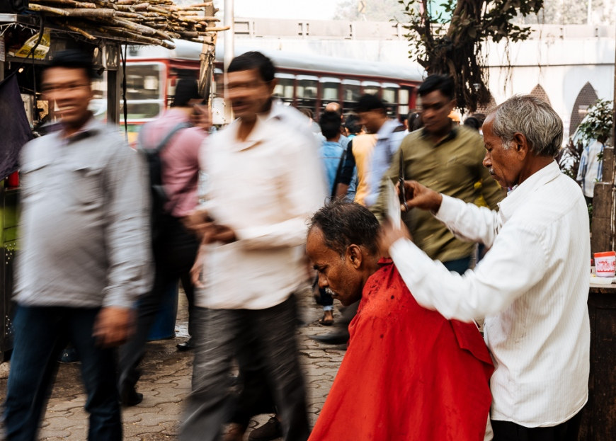 Street barber at work, Mumbai, India