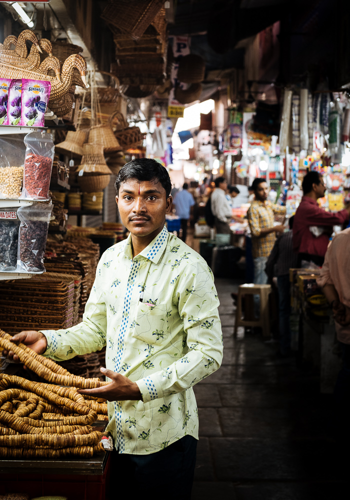 Portrait of shopkeeper, Interior of Crawford Market, Mumbai, India