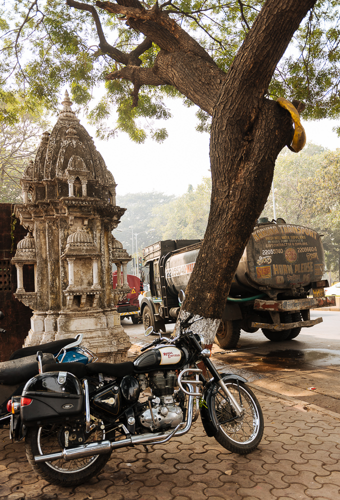 Royal Enfield Motorcycle with Hindu temple in the background, MG Road, Mumbai, India