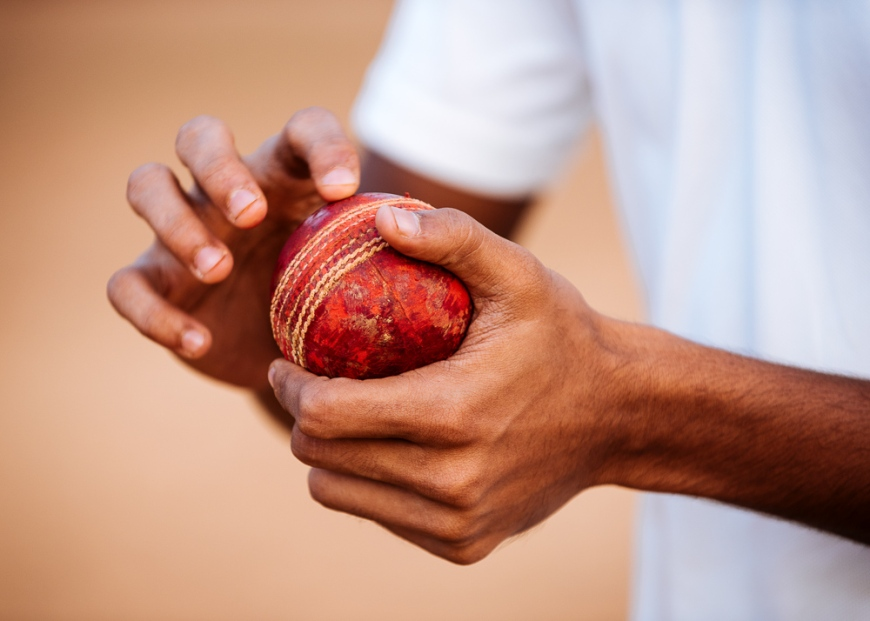 Close up view of man holding cricket ball, Azad Maidan, Mumbai, India