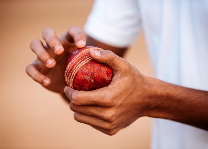 Close up view of man holding cricket ball, Azad Maidan, Mumbai, India