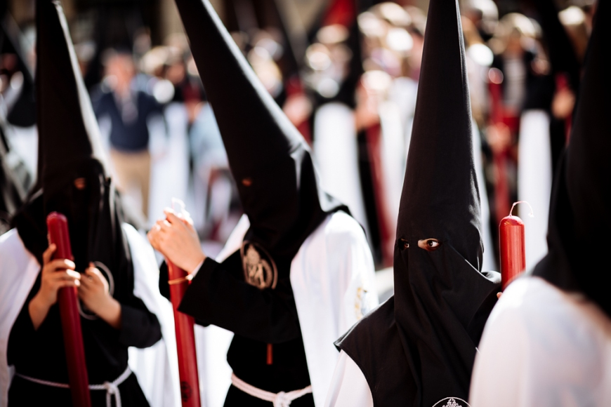 Penitents of 'La Sed' (The Thirst) Brotherhood taking part in processions during Semana Santa (Holy Week), Seville, Andalucia, Spain