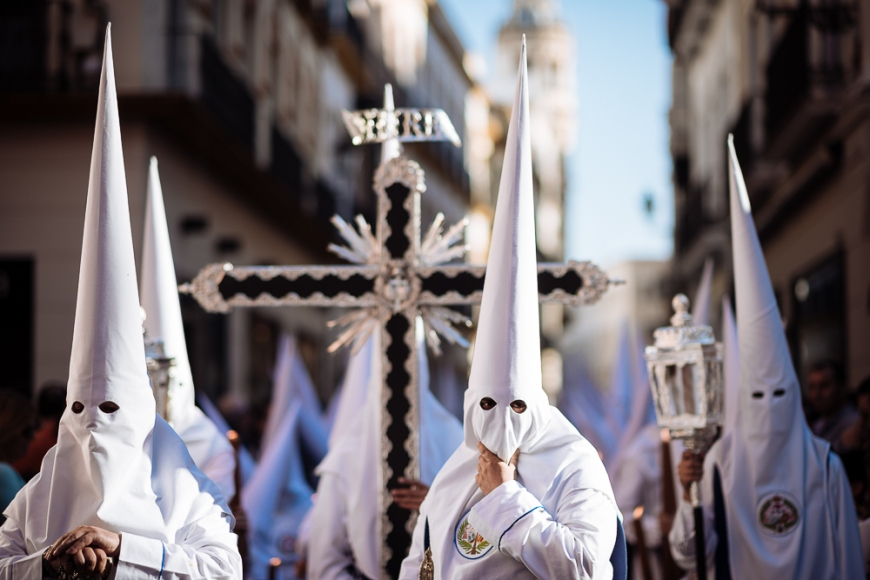 Penitents of 'Los Negritos' Brotherhood taking part in processions during Semana Santa (Holy Week), Seville, Andalucia, Spain