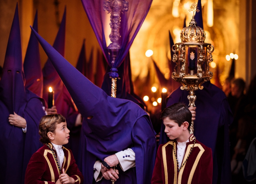Penitents of 'La Quinta Angustia' Brotherhood waiting to begin their procession during Semana Santa (Holy Week), Seville, Andalucia, Spain